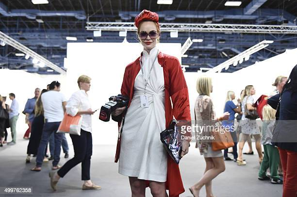 Crazy Rouge is seen wearing a vintage dress and coat and a headpiece from Hong Kong at Art Basel Miami Beach at the Miami Beach Convention Center on...