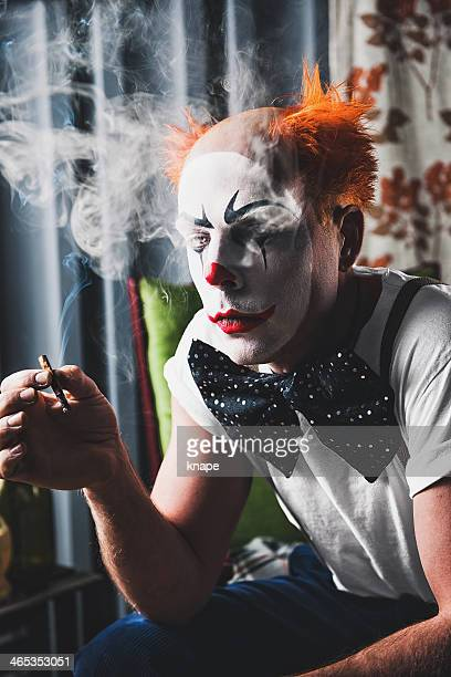 crazy scary clown - sad clown stock photos and pictures