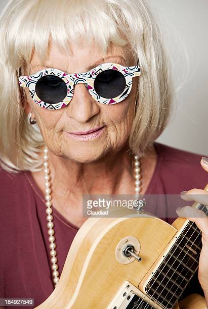Crazy senior woman wiht guitar