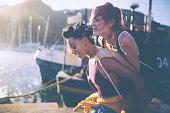 Crazy teen grunge girls piggybacking at the harbour