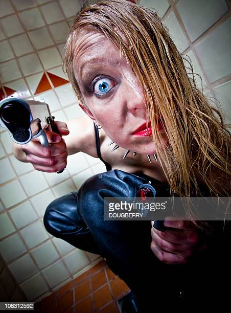 crazy woman in bath stall with guns - shock tactics stock pictures, royalty-free photos & images