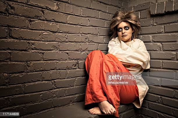 crazy woman wearing a straight jacket in an asylum - psychiatric hospital stock pictures, royalty-free photos & images
