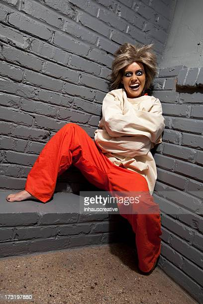 crazy woman wearing a straight jacket in an asylum - straight jacket stock pictures, royalty-free photos & images