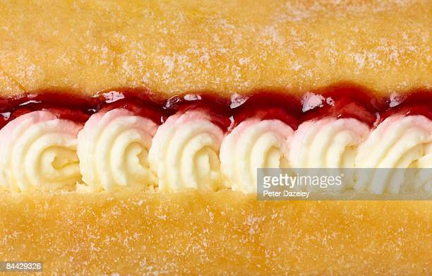 cream and jam filled doughnut - cake stock pictures, royalty-free photos & images