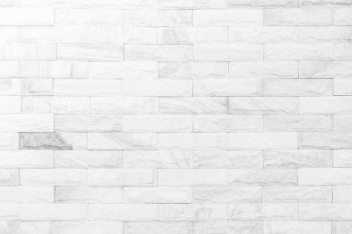 Cream and white brick wall texture background. Brickwork or stonework flooring interior rock old pattern clean concrete grid uneven bricks design stack. 1008177690