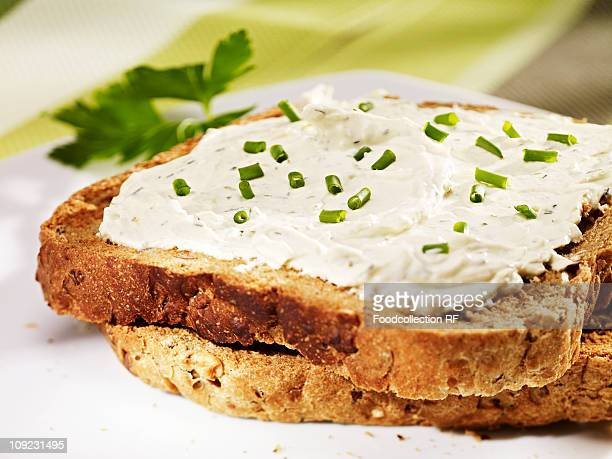 Cream cheese and chives on toast, close-up
