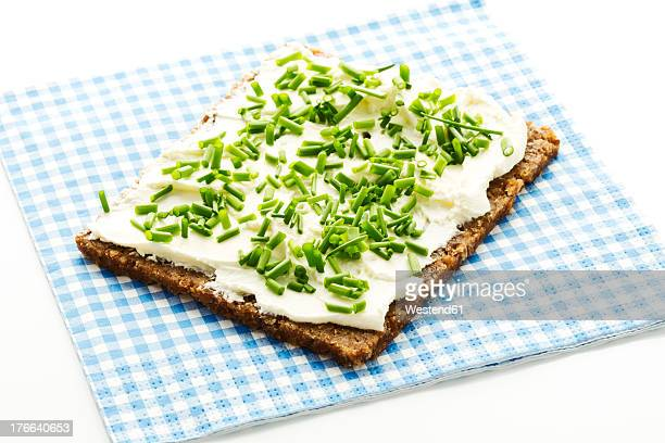 Cream cheese sandwich with chives, close up