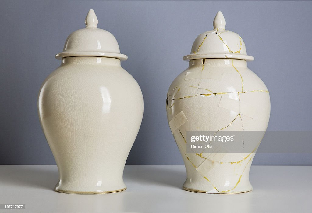 Cream Coloured Vase Next To Broken Repaired One Stock Photo Getty