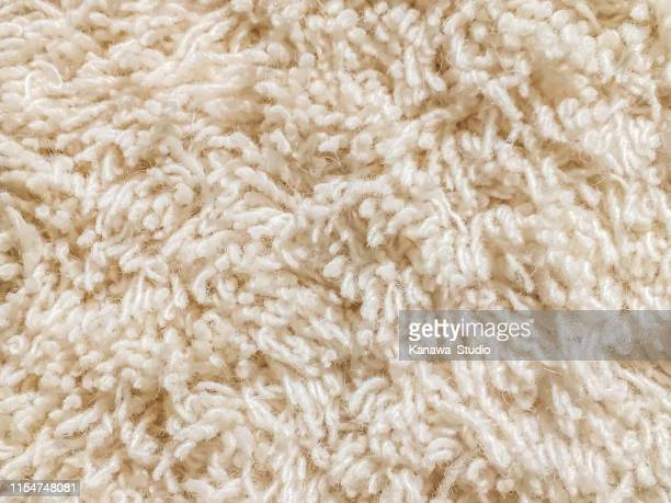 cream cut pile carpet texture - cream colored stock pictures, royalty-free photos & images