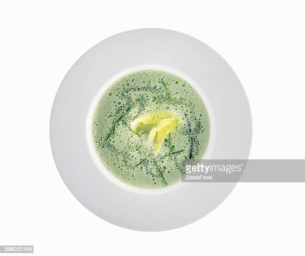 Cream of pea soup with romaine lettuce (overhead view)