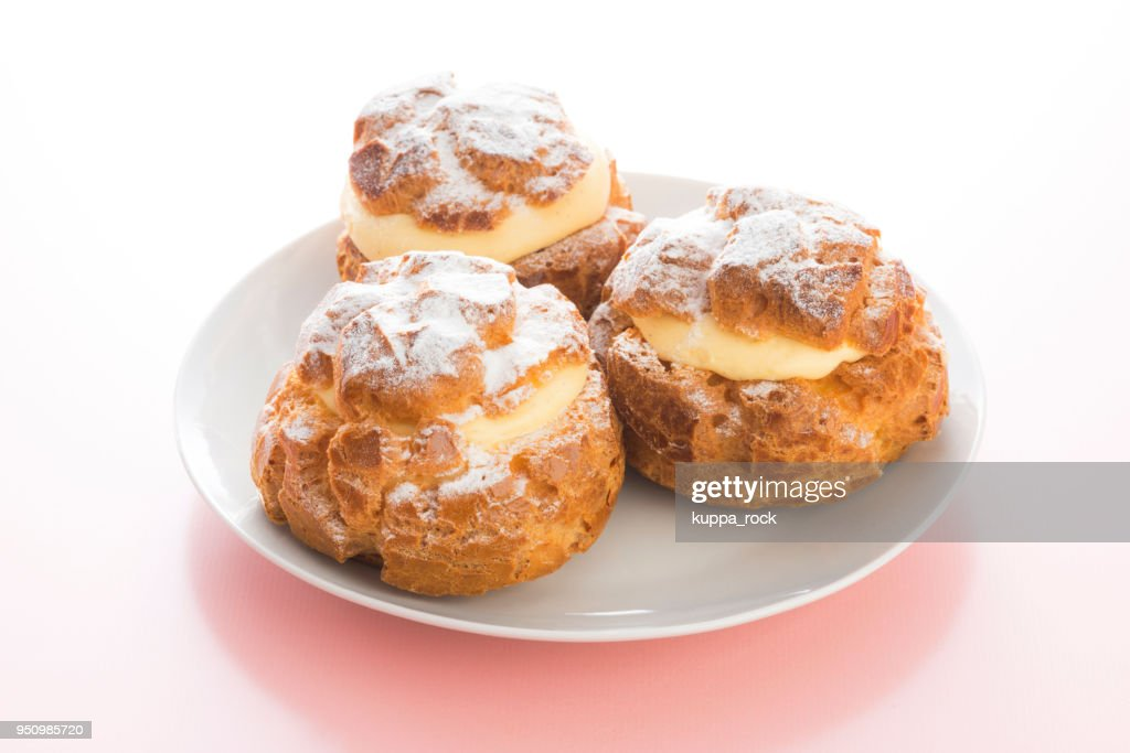Cream puff on a plate : Stock Photo