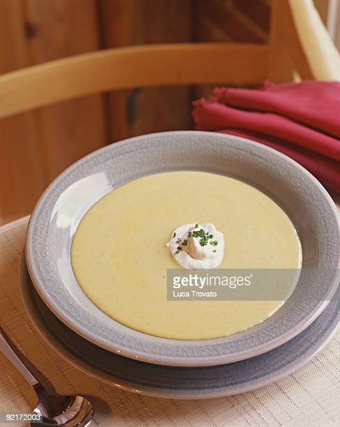 Cream soup with sour cream and chive garnish