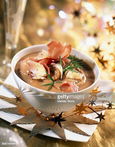 creamed chestnut soup with flakes of serrano ham and parmesan