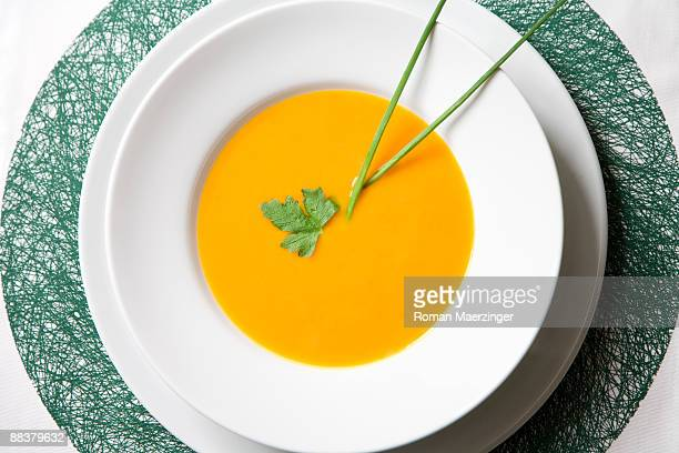 Creamed pumpkin soup, view from above, close-up