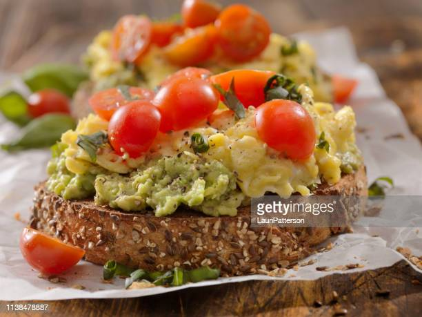creamy avocado sandwich with scrambled eggs and tomatoes - toasted bread stock pictures, royalty-free photos & images