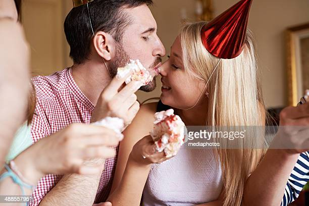 creamy birthday kiss - women whipping men stock photos and pictures