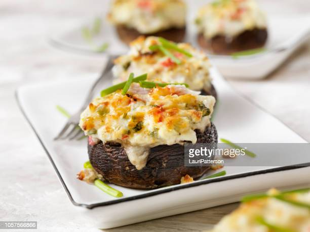 creamy, crab and shrimp stuffed mini portobello mushroom caps - stuffing stock photos and pictures