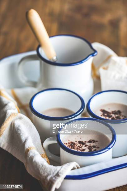 creamy hot chocolates in rustic enamel coffee cups with jug - enamel stock pictures, royalty-free photos & images
