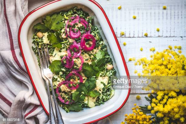 creamy kale salad with pickles and parmesan - spanish onion stock pictures, royalty-free photos & images