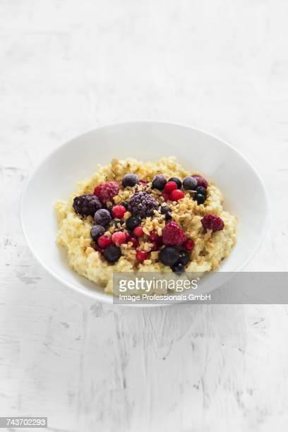 Creamy millet porridge with berries and nuts