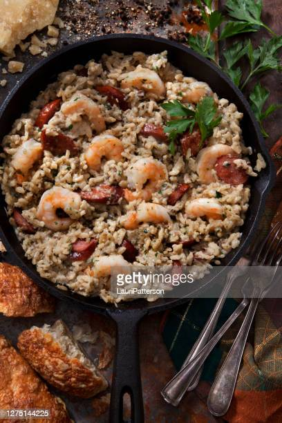 creamy mushroom risotto with shrimp and spicy sausage - seafood stock pictures, royalty-free photos & images