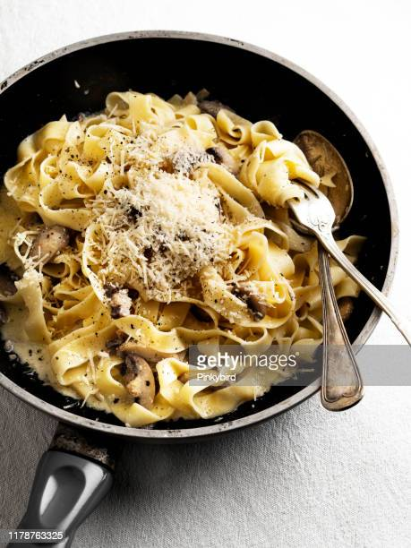 creamy pasta with mushroom,linguini pasta and mushroom,creamy tagliatelle with mushrooms and parmesan cheese, - pasta stock pictures, royalty-free photos & images