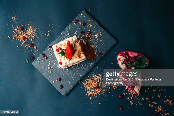 creamy strawberry cake arranged with brown sugar crumbs and pomegranate pieces - base stock pictures, royalty-free photos & images