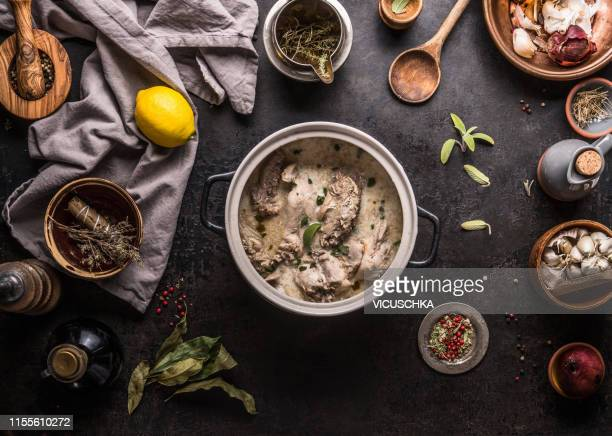 creamy wildfowl ragout or stew in pot on kitchen table with ingredients - french food stock pictures, royalty-free photos & images