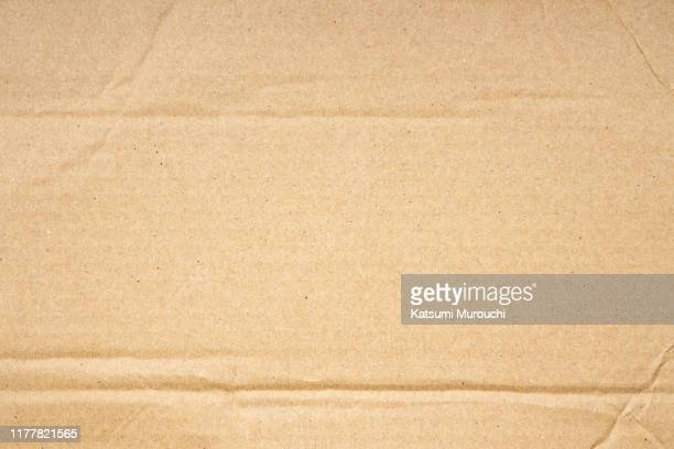 creased cardboard texture background - cardboard stock pictures, royalty-free photos & images