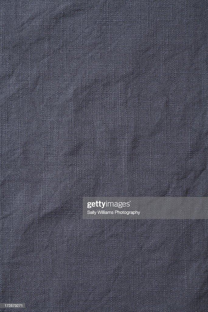 A Creased Grey Cotton Tablecloth : Stock Photo