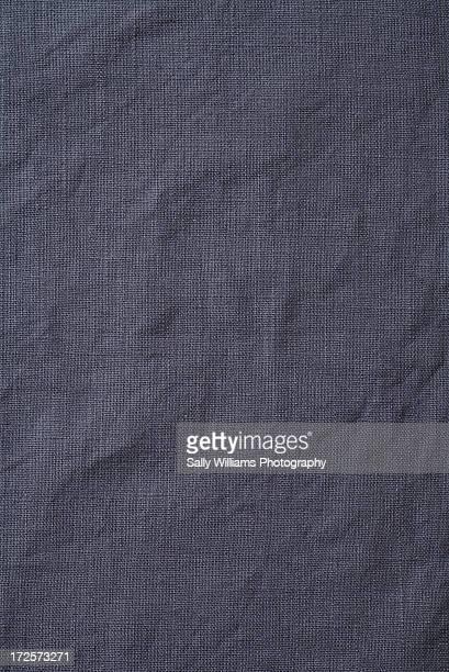 A creased grey cotton tablecloth
