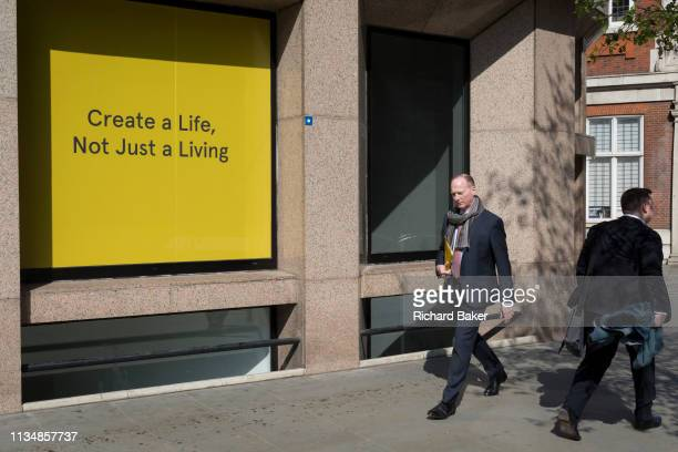 A create a life not just for living slogan outside offices in the City of London the capital's financial district on 1st April in London England