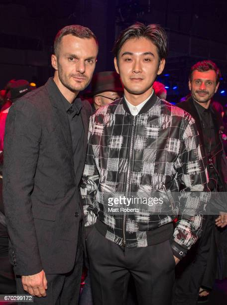 Creatiive Director of Dior Homme Kris Van Assche and Ryuhei Matsuda attend the Dior Homme 2017 Fall Presentation at Differ Ariake on April 19 2017 in...