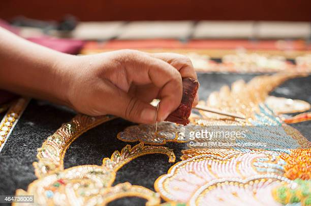 Creating a tapestry, Mandalay, Myanmar