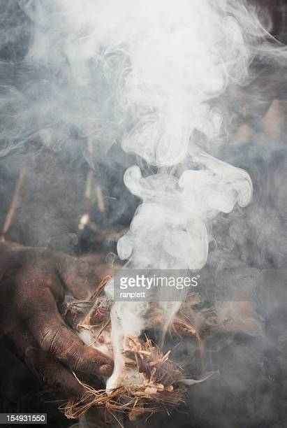 creating fire - african witch doctor stock photos and pictures