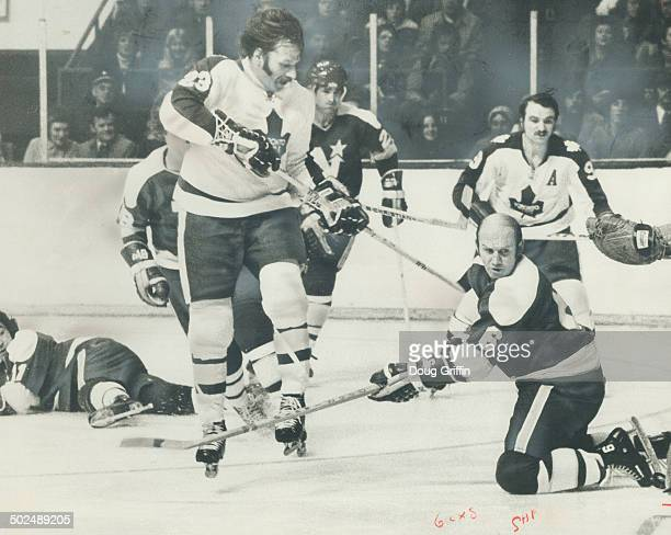 Creating Havog in front of Minnesota North Stars' goal is Maple Leafs' irrepressible Eddie Shack who earned star rating for his performace in team's...