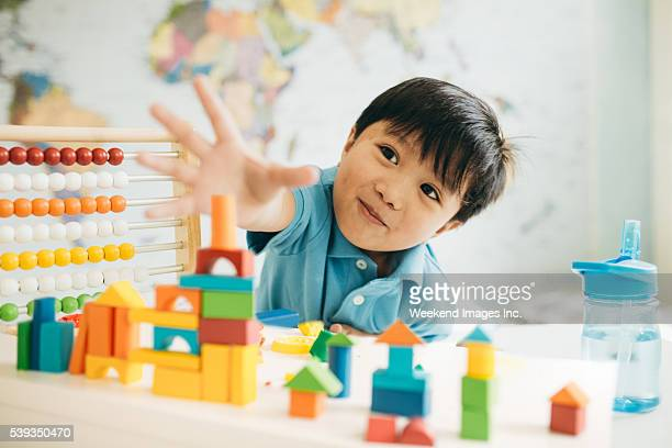 Creating new cities with wooden blocks