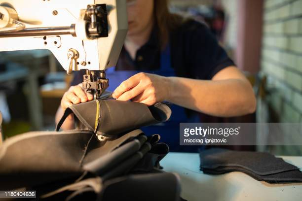 creating something beautiful on sewing machine - shoe factory stock pictures, royalty-free photos & images