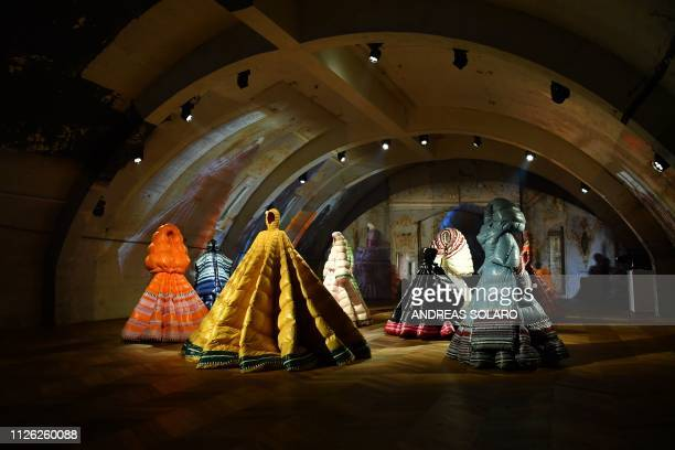 TOPSHOT Creations are displayed during the Moncler women's Fall/Winter 2019/2020 collection fashion show on February 20 2019 in Milan