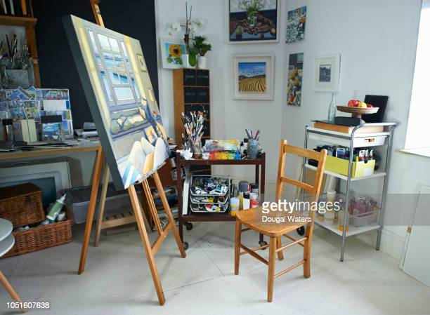 creative artist studio with painting on easel. - easel stock pictures, royalty-free photos & images