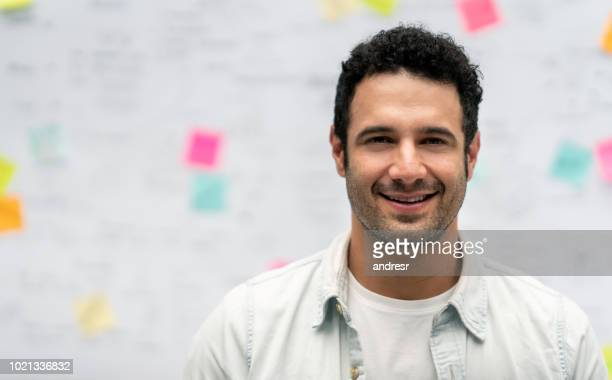 creative business man at the office in front of a whiteboard - business plan stock pictures, royalty-free photos & images