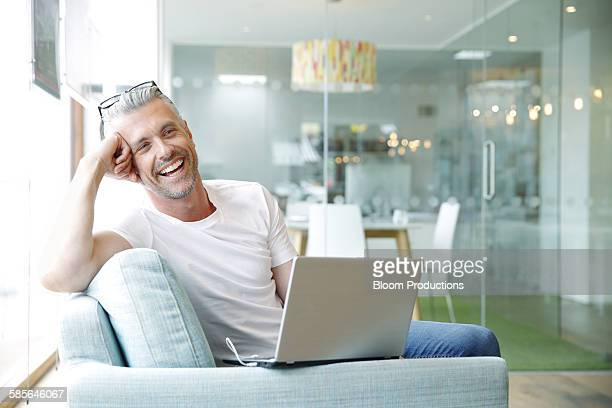 Creative business man in office laughing