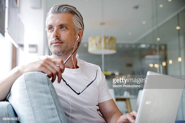 creative business man using a digital tablet - grey hair stock pictures, royalty-free photos & images