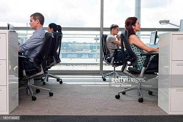 Creative business people at workstations