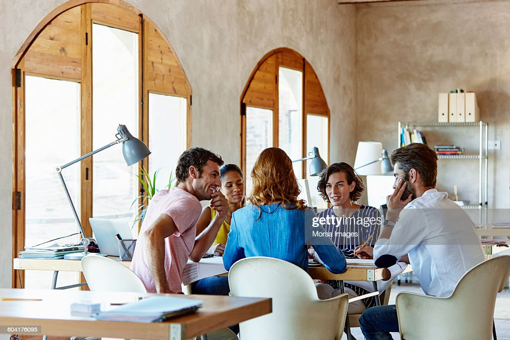 Creative business people discussing in office : Stockfoto