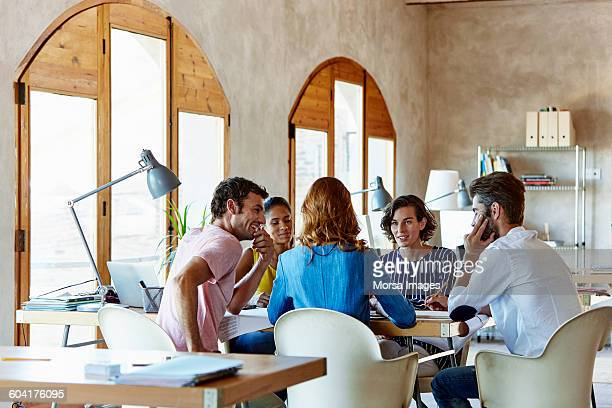 Creative business people discussing in office