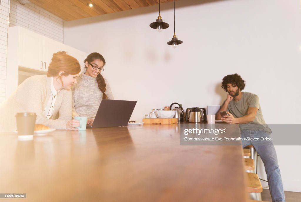 Creative business people having informal meeting in office kitchen : Stock Photo