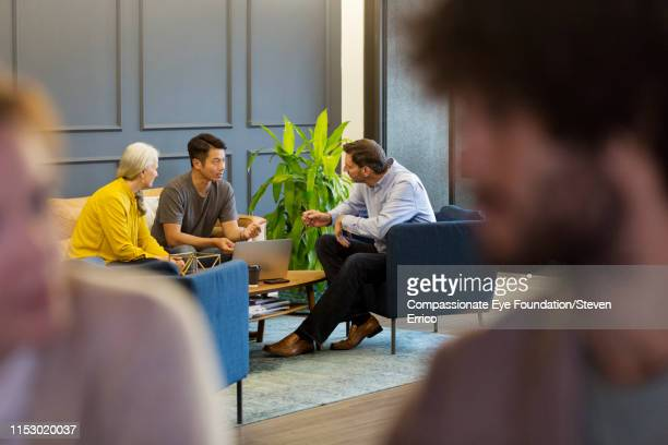 creative business people having meeting in co-working space - photography stock pictures, royalty-free photos & images