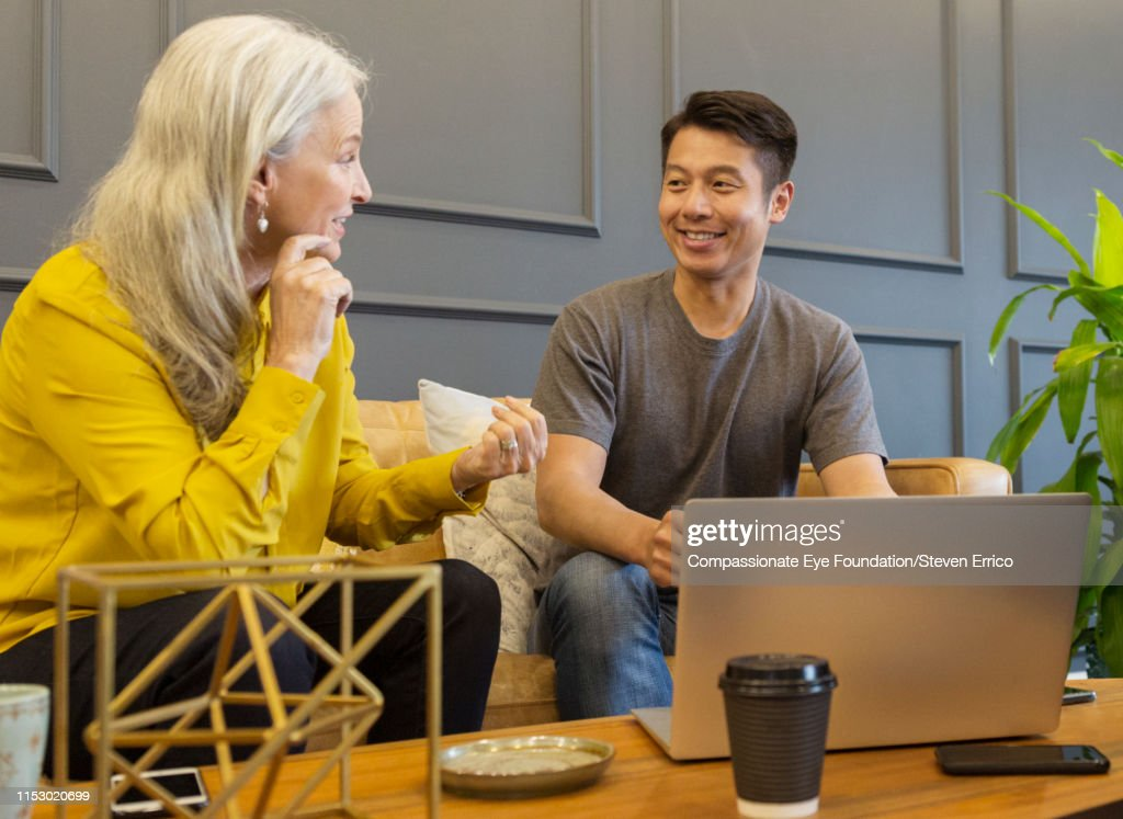 Creative business people having meeting in co-working space : Stock Photo