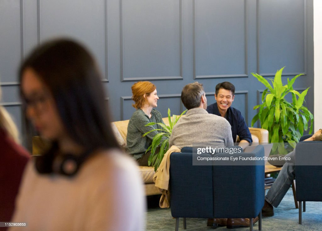 Creative business people having meeting in modern open plan office : Stock Photo